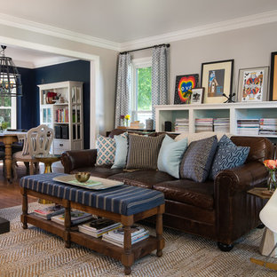 Inspiration for a timeless living room library remodel in Detroit with gray walls