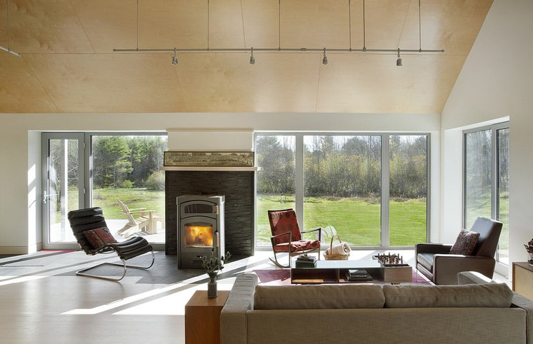 Farmhouse Living Room by ZeroEnergy Design