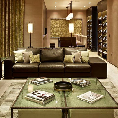 Inspiration for a contemporary open concept living room remodel in London with beige walls and no tv