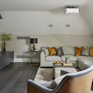 Inspiration for a large contemporary enclosed living room in London with beige walls, medium hardwood flooring, a wall mounted tv, grey floors and a vaulted ceiling.