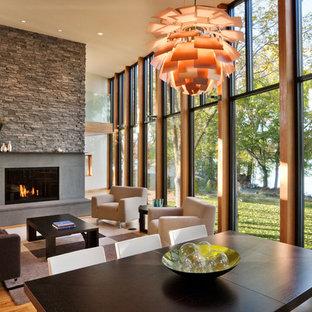 Foto de salón minimalista con marco de chimenea de hormigón