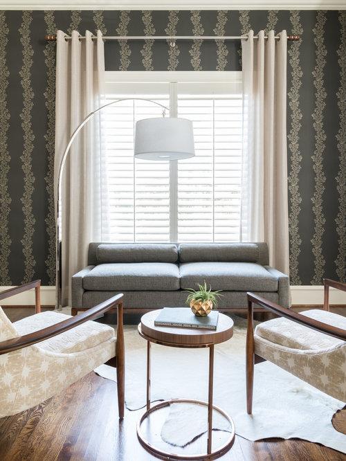 midsized open concept medium tone wood floor and brown floor living room idea