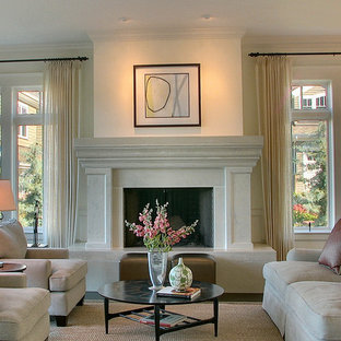 Living room - contemporary living room idea in Seattle with a standard fireplace
