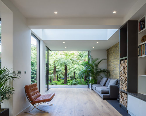 Photo Of A Medium Sized Contemporary Open Plan Living Room In London With  Light Hardwood Flooring Part 87