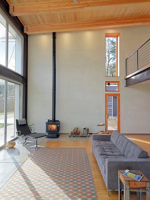best high ceiling living room with a wood stove design ideas - Wood Stove Design Ideas