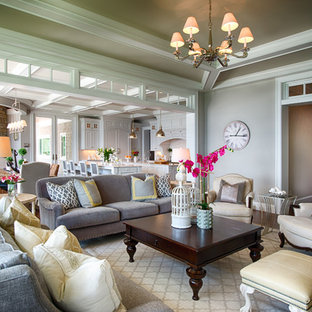 This is an example of a classic formal open plan living room in Minneapolis with grey walls.