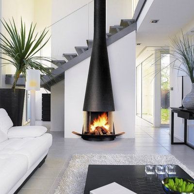 Trendy living room photo in Devon with white walls and a wood stove