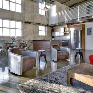 Exempel på ett stort industriellt vardagsrum, med betonggolv