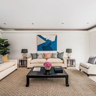 This is an example of a large traditional formal enclosed living room in London with beige walls and beige floors.