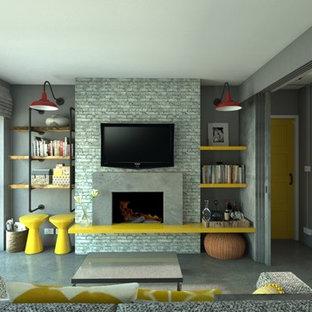 ロンドンの小さいインダストリアルスタイルのおしゃれなリビング (グレーの壁、コンクリートの床、コンクリートの暖炉まわり) の写真