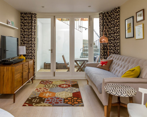 Photo Of A Retro Living Room In London With Beige Walls, No Fireplace And A