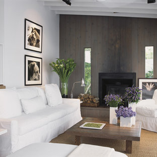 Inspiration for a modern living room remodel in New York with white walls and a standard fireplace