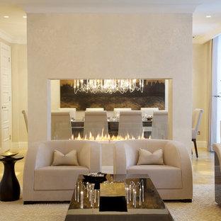 ニューヨークの中くらいのコンテンポラリースタイルのおしゃれな独立型リビング (横長型暖炉、フォーマル、ベージュの壁、淡色無垢フローリング、漆喰の暖炉まわり、テレビなし) の写真