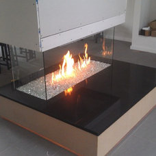 Contemporary Fireplaces by KJB FIREPLACES