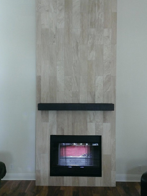Custom Surface Solutions - Owner Craig Thompson (512) 430-1215. This project shows a fireplace that is 5
