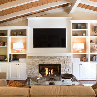 Inspiration for a mid-sized transitional open concept medium tone wood floor living room remodel in Los Angeles with beige walls, a standard fireplace, a stone fireplace and a media wall