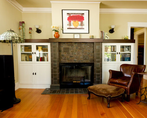 traditional enclosed living room idea in san francisco with beige walls - Fireplace Tile Design Ideas