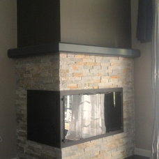 Contemporary Indoor Fireplaces by KJB FIREPLACES