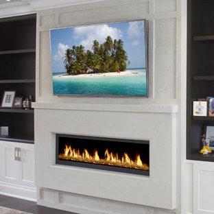 Ejemplo de salón para visitas cerrado, contemporáneo, pequeño, con paredes blancas, suelo de madera en tonos medios, chimenea tradicional, marco de chimenea de piedra, televisor colgado en la pared y suelo marrón