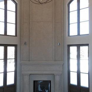 Ispirazione per un grande soggiorno design chiuso con sala formale, pareti beige, pavimento beige, pavimento in marmo, camino ad angolo e cornice del camino in pietra