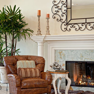 Photo of a mid-sized traditional living room in Miami with beige walls, limestone floors, a standard fireplace, a tile fireplace surround and no tv.