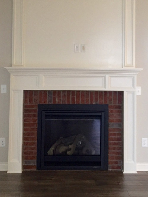 living room design ideas renovations photos with a brick fireplace