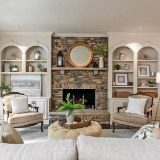 Living room - large traditional formal medium tone wood floor and brown floor living room idea in Charlotte with beige walls, a standard fireplace and a stone fireplace