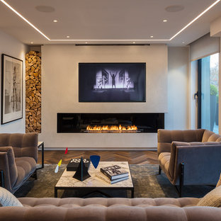 Inspiration for a medium sized contemporary living room in London with white walls, a ribbon fireplace, a built-in media unit and brown floors.