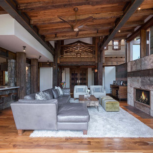 Inspiration for a large rustic open concept medium tone wood floor living room remodel in Phoenix with a ribbon fireplace, white walls and a metal fireplace
