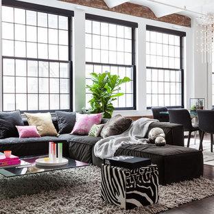 Example of a trendy open concept dark wood floor and brown floor living room design in New York