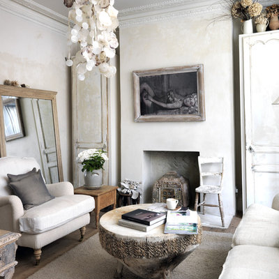 Mid-sized cottage chic enclosed living room photo in London with beige walls