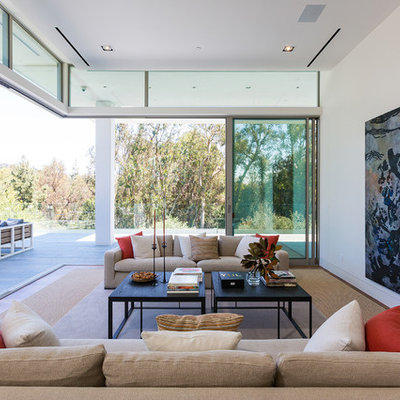 Mid-sized trendy formal and open concept living room photo in Los Angeles with white walls