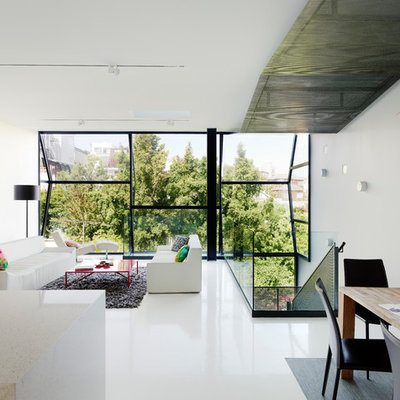 Inspiration for a contemporary open concept living room remodel in San Francisco with white walls