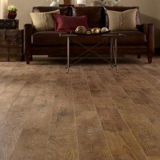 Mid-sized elegant open concept medium tone wood floor living room photo in Phoenix with beige walls
