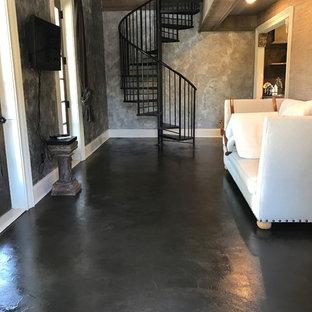 アトランタのシャビーシック調のおしゃれなリビング (コンクリートの床、茶色い床) の写真