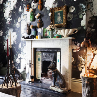 Design ideas for a bohemian living room in London with multi-coloured walls, dark hardwood flooring, a standard fireplace and a stone fireplace surround.