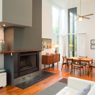 Inspiration for a contemporary open concept dark wood floor living room remodel in Atlanta with white walls, a standard fireplace and a tv stand