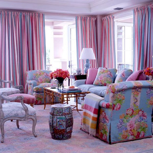 This is an example of a large traditional enclosed living room in New York with carpet and pink walls.