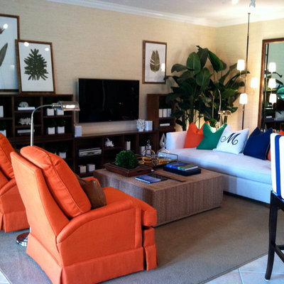 Living room - tropical open concept carpeted living room idea in New York with beige walls and a wall-mounted tv