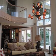 Tropical Living Room by Progressive Construction, Inc.