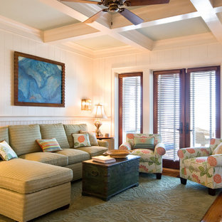 Example of a mid-sized classic formal and enclosed medium tone wood floor living room design in Charleston with white walls