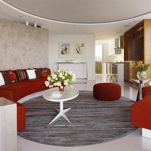 Imagen de salón abierto, minimalista, pequeño, con paredes grises y suelo de mármol