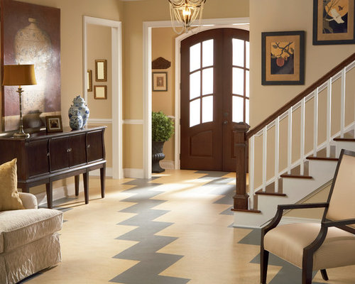 living room large traditional open concept linoleum floor living room idea in chicago with beige