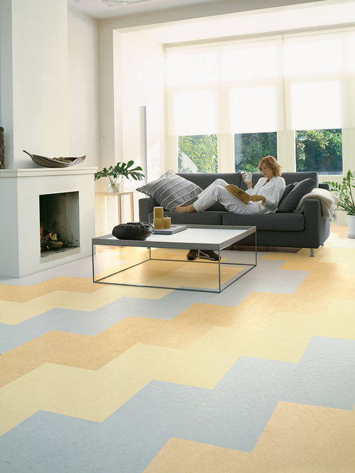 large minimalist open concept linoleum floor living room photo in chicago with white walls a