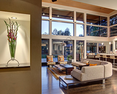 Example Of A Trendy Open Concept Living Room Design In Seattle With White  Walls