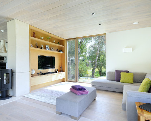 contemporary living room furniture ideas. photo of a modern open plan living room in hampshire with white walls, light hardwood contemporary furniture ideas