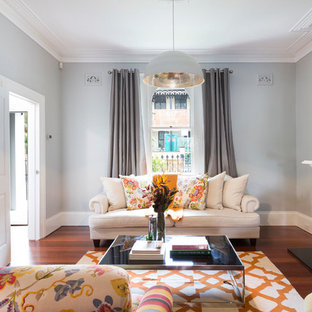 Large traditional formal enclosed living room in Sydney with grey walls, dark hardwood floors, a standard fireplace, a wood fireplace surround, brown floor and no tv.