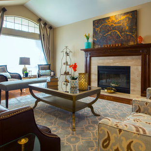 Example of a mid-sized transitional formal and open concept dark wood floor living room design in San Francisco with a stone fireplace, no tv, beige walls and a standard fireplace