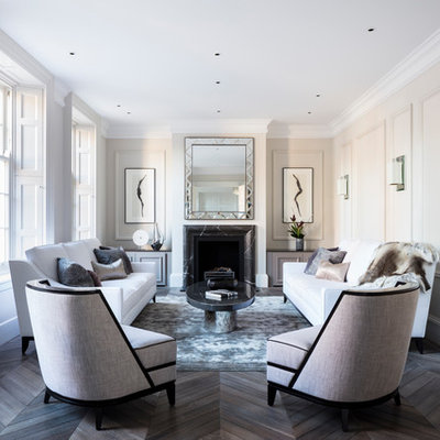 Mid-sized trendy enclosed and formal dark wood floor living room photo in London with a stone fireplace, beige walls, a standard fireplace and no tv
