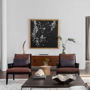 Foto de salón tipo loft, moderno, grande, sin chimenea y televisor, con paredes blancas, suelo de madera oscura y suelo marrón